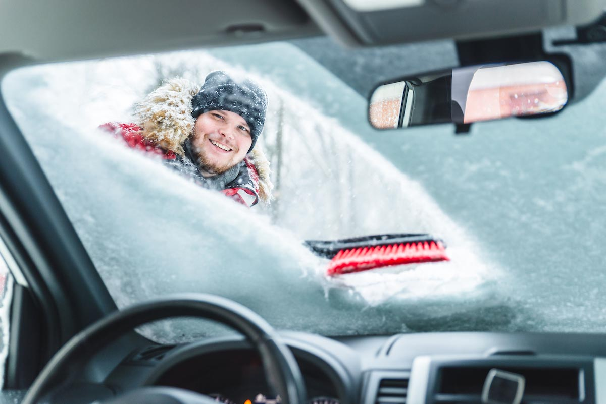Manually remove snow from the front windshield